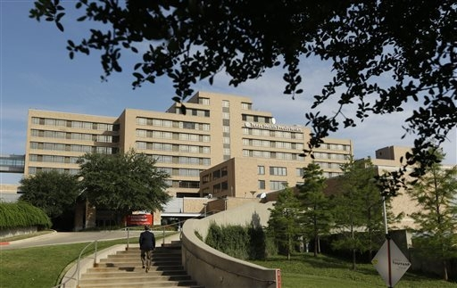 A man walks up the stairway leading to the Texas Health Presbyterian Hospital in Dallas, Tuesday, Sept. 30, 2014.  A patient in the hospital is showing signs of the Ebola virus and is being kept i ...
