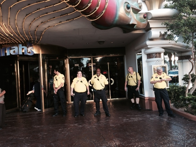 Hotel security from Harrah's stand in front of the hotel-casino as fast-food workers protest on the Las Vegas Strip Thursday morning, Sept. 4, 2014. Organizers say the workers in Las Vegas and aro ...