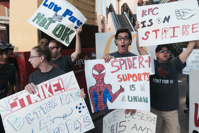 Fast-food workers protest on the Las Vegas Strip Thursday morning, Sept. 4, 2014. Organizers say the workers in Las Vegas and around the country are seeking better pay and the right to form a unio ...