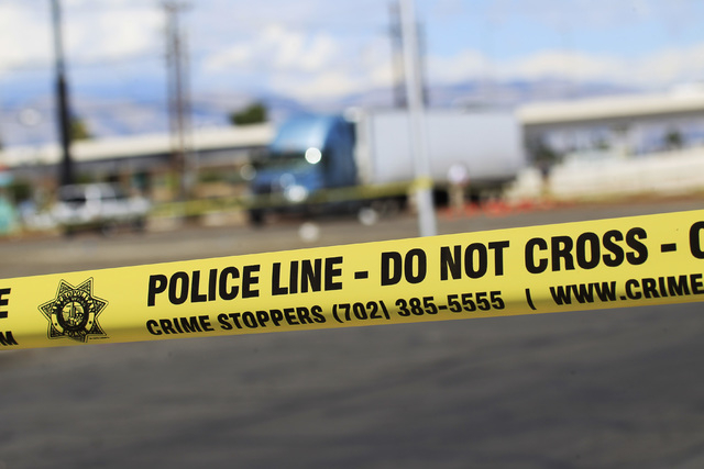 Metro detectives investigate the scene of a fatal accident where a man was run over by a semi truck Sunday, Sept. 21, 2014 near 6th Street and Mesquite Avenue downtown Las Vegas. (Sam Morris/Las V ...