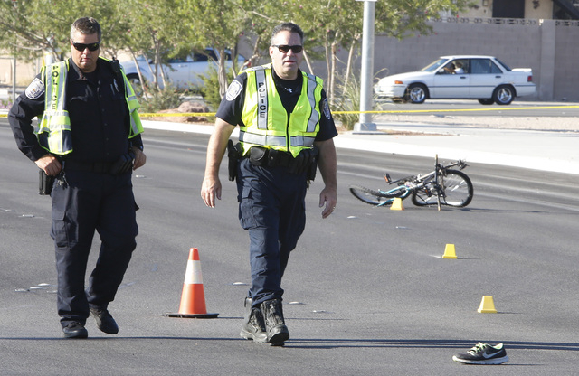 North Las Vegas police investigate the fatal accident near the Lake Mead Boulevard and North Fifth Street intersection, on Saturday, Sept. 13, 2014, in North Las Vegas. A bicyclist died at the sce ...