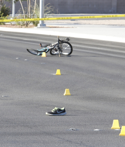 A shoe and a bicycle are seen at the accident scene near the Lake Mead Boulevard and North Fifth Street intersection, on Saturday, Sept. 13, 2014, in North Las Vegas. A bicyclist died at the scene ...
