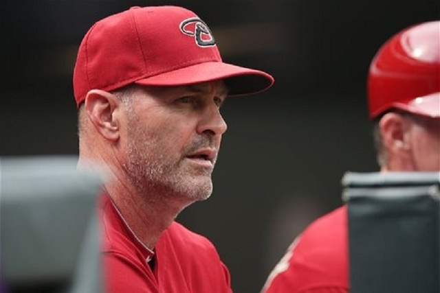 Arizona Diamondbacks manager Kirk Gibson looks on against the Colorado Rockies in the first inning of a baseball game in Denver on Sunday, Sept. 21, 2014. (AP Photo/David Zalubowski)