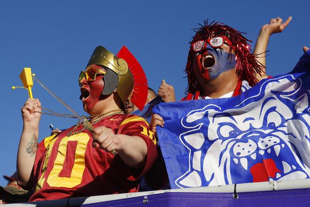Opposing fans cheer next to each other as USC takes on Fresno State during the Royal Purple Las Vegas Bowl at Sam Boyd Stadium in Las Vegas on Dec. 21, 2013. (Jason Bean/Las Vegas Review-Journal)