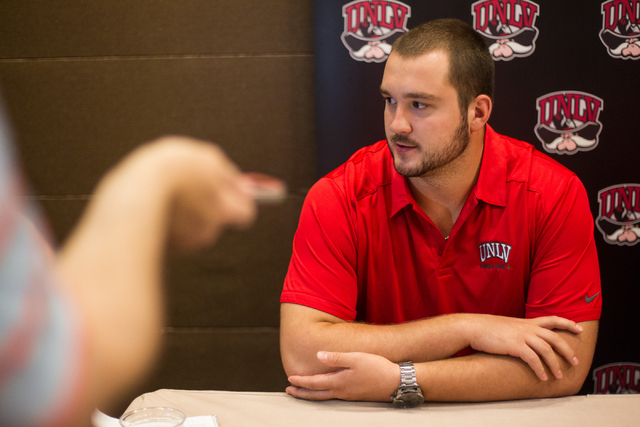 UNLV's Brett Boyko speaks with news media during the Mountain West Conference football media days at the Cosmopolitan hotel-casino in Las Vegas on Wednesday, July 23, 2014. He's one of 10 Rebel pl ...