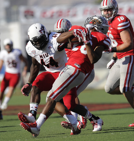 UNLV Rebels running back Keith Whitely (28) spins around Northern Illinois defensive end Perez Ford (44) to gain extra yardage on a kick return in the first half of their NCAA Football game at Sam ...