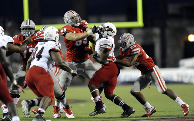 UNLV Rebels offensive lineman Brett Boyko (69) battles Northern Illinois defensive end Ladell Fleming (8) in the second half of their NCAA Football game at Sam Boyd Stadium in Las Vegas Saturday,  ...