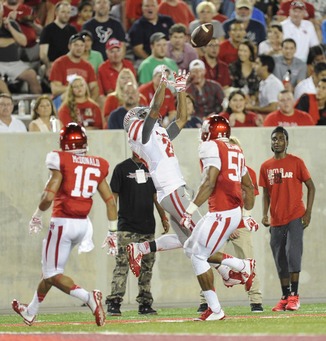 UNLV Rebels running back Keith Whitely (28) catches a pass out of bounds against the Houston Cougars in the first half of an NCAA Football game against the Houston Cougars  at TDECU Stadium in Hou ...