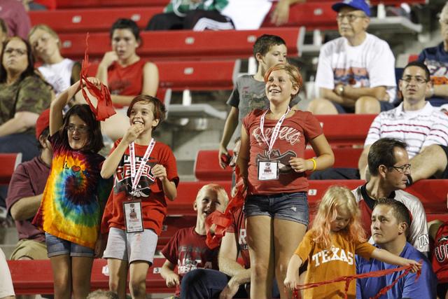 UNLV Rebels fans cheer their football team against Northern Colorado Bears at Sam Boyd Stadium in Las Vegas Saturday, Sept. 6, 2014. UNLV won 13-12. (Erik Verduzco/Las Vegas Review-Journal)