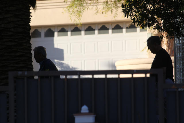 FBI agents investigate while serving a federal search warrant at a home at 4311 E. Oquendo Road in Las Vegas on Monday, Sept. 29, 2014. The FBI did not give any other details other than that no ar ...