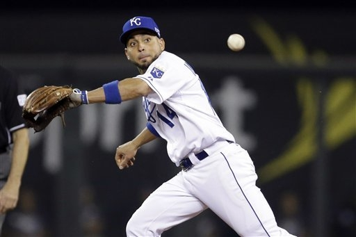 Kansas City Royals second baseman Omar Infante cannot stop a ball hit by Oakland Athletics' Josh Reddick for a single during the seventh inning of the AL wild-card playoff baseball game Tuesday, S ...