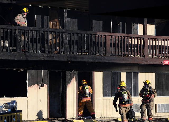 Clark County firefighters work a two-alarm fire at the Americana Inn on Harmon Avenue near the Las Vegas Strip on Wednesday, Sept. 24, 2014.(Justin Yurkanin/Las Vegas Review-Journal)