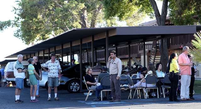 People wait outside the scene a two-alarm fire at the Americana Inn on Harmon Avenue near the Las Vegas Strip on Wednesday, Sept. 24, 2014.(Justin Yurkanin/Las Vegas Review-Journal)