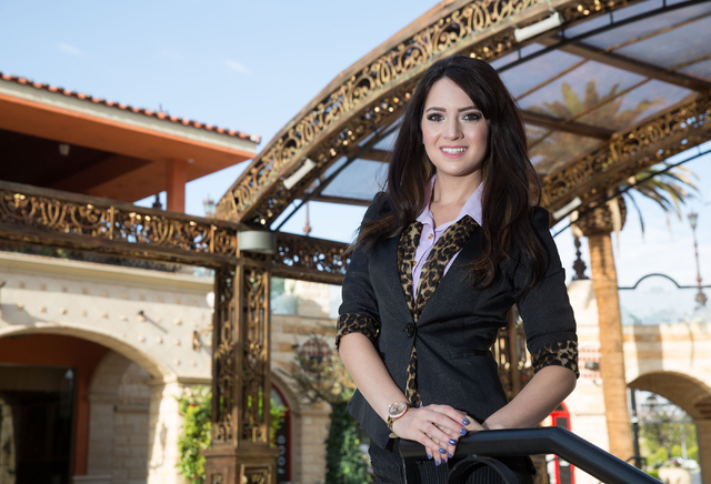 Summerlin resident Lisa Coruzzi stands inside Tivoli Village, July 28. The UNLV graduate studied integrated marketing communications and attended mixers, events and anything where she could meet t ...