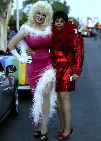 """Participants who call themselves """"Dolly Woods,"""" left, and """"Jamie Kurtis"""" pose before the start of the Gay Pride Parade in downtown Las Vegas on Friday night, May 2, 2008. (Ralph Fountain/Las Vegas ..."""