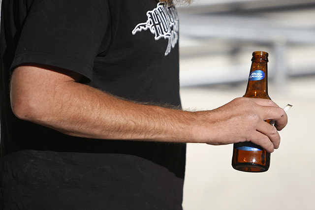 A man walks holding his beer bottle near The Linq in Las Vegas Tuesday, Aug. 26, 2014. (Erik Verduzco/Las Vegas Review-Journal)