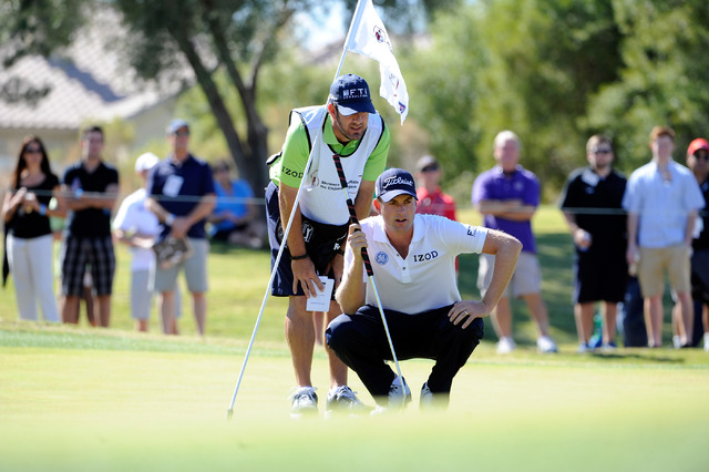 Webb Simpson looks over his putt with his caddie Paul Tesori during the third round of the Shriner Hospital for Children Open at the TPC Summerlin last year. Simpson was selected to the Ryder Cup  ...