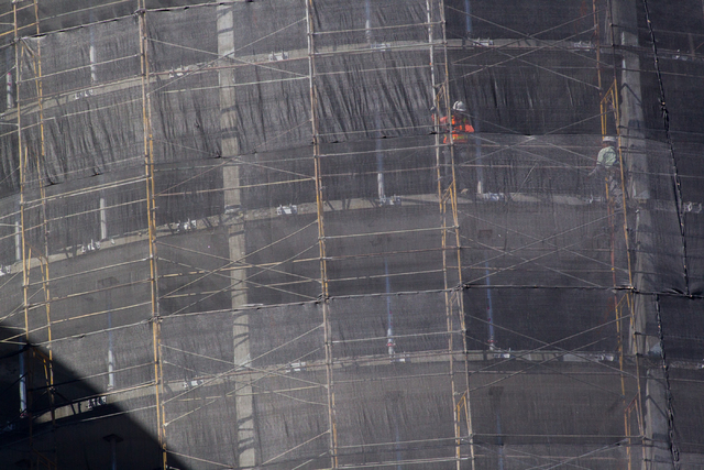Construction crews, upper right, work on demolishing the unfinished Harmon Hotel at CityCenter in Las Vegas on Monday, Sept. 22, 2014. The building is being taken down because it was found to be u ...