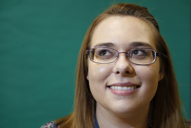 Allysa Starkweather, math teacher at Schofield Middle School, poses for a portrait inside her classroom in Henderson Tuesday, Aug. 26, 2014. Starkweather, 23, is a recent college graduate and firs ...