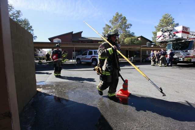 Firefighters leave the area after responding to a fire that left one man dead in an apartment complex on 2825 Bluegrass Lane in Henderson  on Tuesday, Sept. 30, 2014. (Chase Stevens/Las Vegas Revi ...
