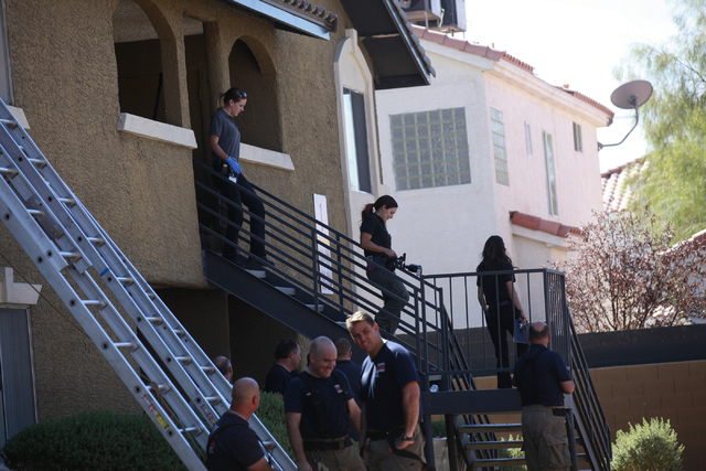 Henderson officials investigate a fire that left one man dead in an apartment complex on 2825 Bluegrass Lane in Henderson  on Tuesday, Sept. 30, 2014. (Chase Stevens/Las Vegas Review-Journal)