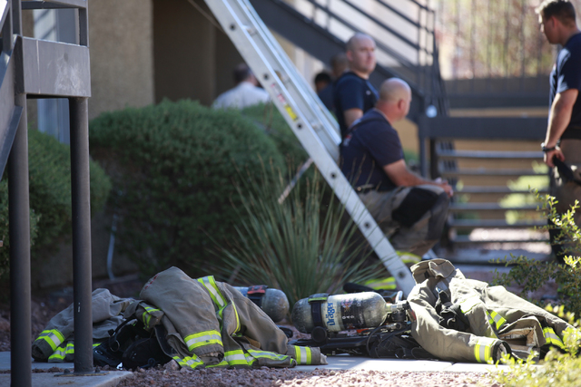Firefighters' equipment is seen after responding to a fire that left one man dead in an apartment complex on 2825 Bluegrass Lane in Henderson  on Tuesday, Sept. 30, 2014. (Chase Stevens/Las Vegas  ...