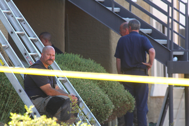 A firefighter sits on a ladder after responding to a fire that left one man dead in an apartment complex on 2825 Bluegrass Lane in Henderson  on Tuesday, Sept. 30, 2014. (Chase Stevens/Las Vegas R ...