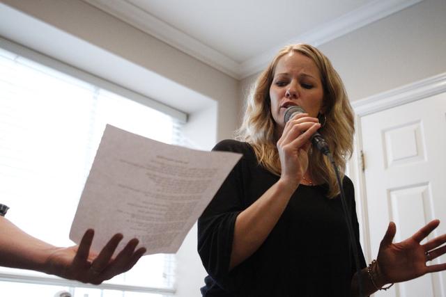 Singer Kristen Hertzenberg sings during a rehearsal at a private home in Las Vegas Tuesday, Sept. 16, 2014. (Erik Verduzco/Las Vegas Review-Journal)