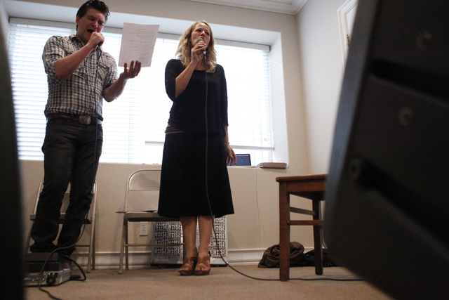 Singer Kristen Hertzenberg, right, sings a song with guitarist Benjamin Hale during a music rehearsal at a private home in Las Vegas Tuesday, Sept. 16, 2014. (Erik Verduzco/Las Vegas Review-Journal)