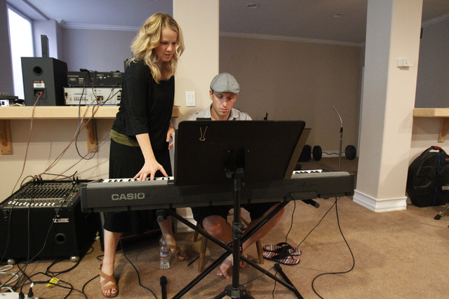 Singer Kristen Hertzenberg, left, speaks with Martin Kaye, during a rehearsal at a private home in Las Vegas Tuesday, Sept. 16, 2014. (Erik Verduzco/Las Vegas Review-Journal)