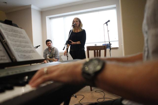Singer Kristen Hertzenberg, center, sings during a music rehearsal as guitarist Benjamin Hale looks on at a private home in Las Vegas Tuesday, Sept. 16, 2014. (Erik Verduzco/Las Vegas Review-Journal)
