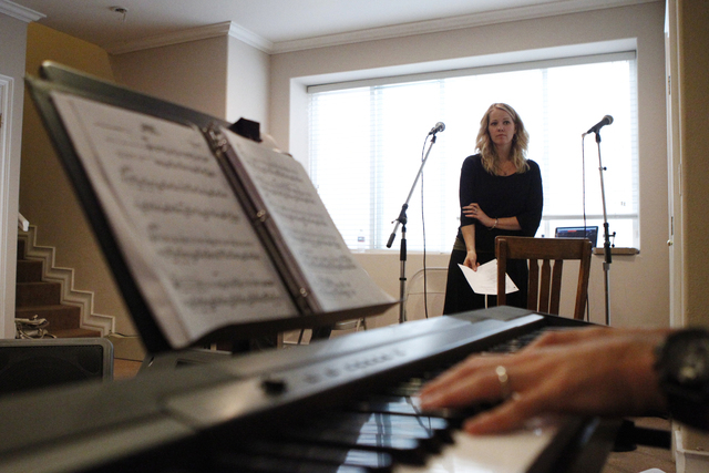 Singer Kristen Hertzenberg waits for her cue during a music rehearsal at a private home in Las Vegas Tuesday, Sept. 16, 2014. (Erik Verduzco/Las Vegas Review-Journal)