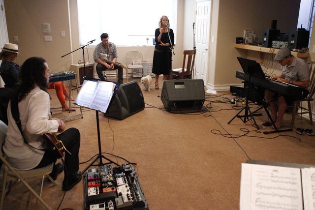 Singer Kristen Hertzenberg, center, sings with her music group during a rehearsal at a private home in Las Vegas Tuesday, Sept. 16, 2014. (Erik Verduzco/Las Vegas Review-Journal)