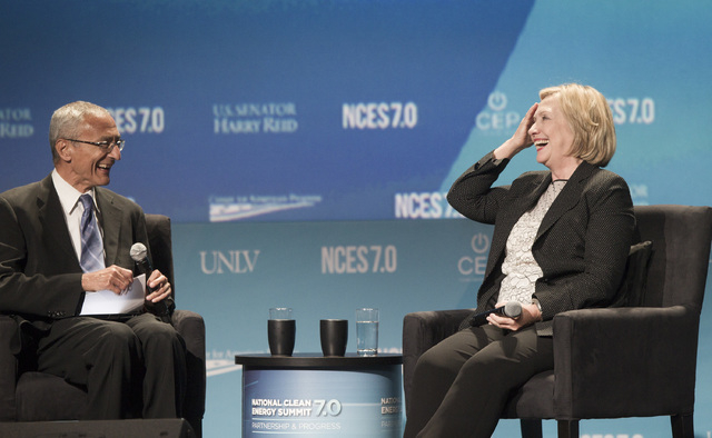 John Podesta, left ,counselor to President Obama, and Hillary Clinton, former Secretary of State, during question and answer session at National Clean Energy Summit 7.0: Partnership & Progress at  ...