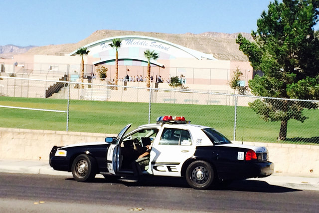 A Las Vegas police car is seen near the hit-and-run Friday morning, Sept. 26, 2014, where a juvenile was struck by a vehicle, near Fertitta Middle School. (Bizu Tesfaye/Las Vegas Review-Journal)