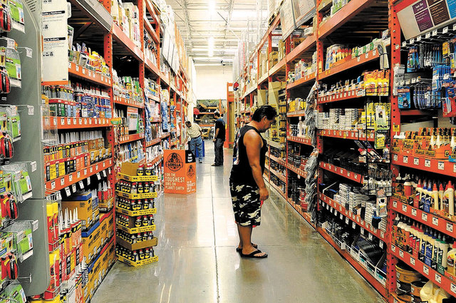 Renwick Adriano from Hawaii looks for refinishing items at Home Depot in 2011. The Atlanta home improvement retailer said Tuesday, Sept. 2, 2014, it is investigating a potential credit card data b ...