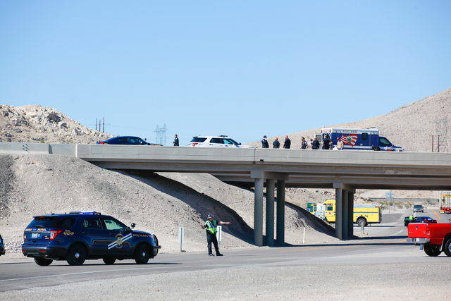 Nevada Highway Patrol and North Las Vegas police officers, along with negotiators, respond to a situation where a man threatened to harm himself on the I-15 at the Las Vegas Boulevard exit, north  ...