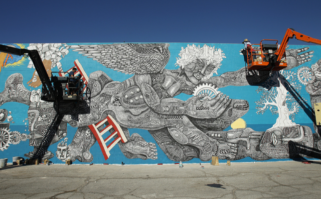 Cody Chapman, left, assists Zio Ziegler, right, paint a mural in downtown Las Vegas Thursday, Oct. 24, 2013. The mural is one of many painted for the inaugural Life is Beautiful festival.  (John L ...