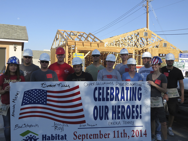 Habitat for Humanity Las Vegas partners with military and law enforcement members to honor 9/11 heroes and the service personnel who continue to protect the country at home and abroad by building  ...