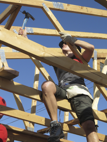 Jessica Rayl, member of Habitat for Humanity, helps build a home for a local low-income family in need as a way to honor 9/11 heroes and the service personnel who continue to protect the country a ...