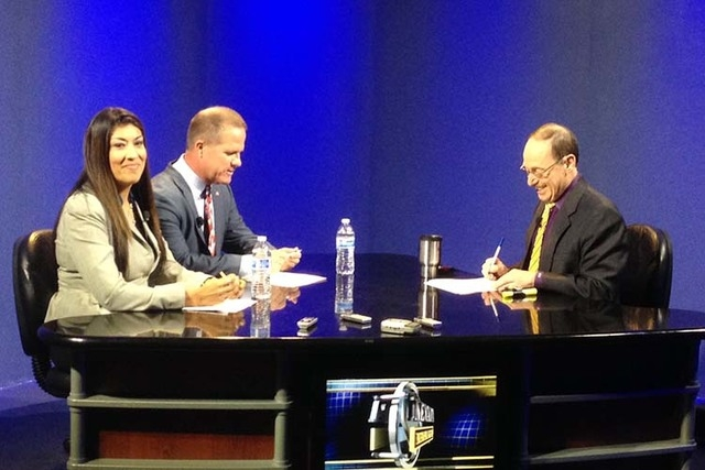 Lieutenant Governor candidates Lucy Flores and Mark Hutchison, left, prepare to answer questions posed by Nevada NewsMakers host Sam Shad during a debate taped Monday, Sept. 29, in Reno. (Sean Wha ...
