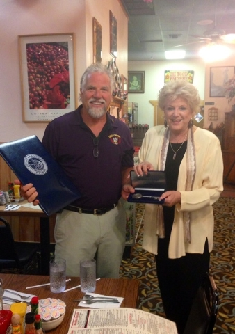 """Kevin Mills, owner of the Omelet House, poses with City of Las Vegas Mayor Carolyn Goodman after receiving a key to the city at his restaurant on Friday, Sept. 12. Goodman proclaimed Sept. 12 """"Kev ..."""
