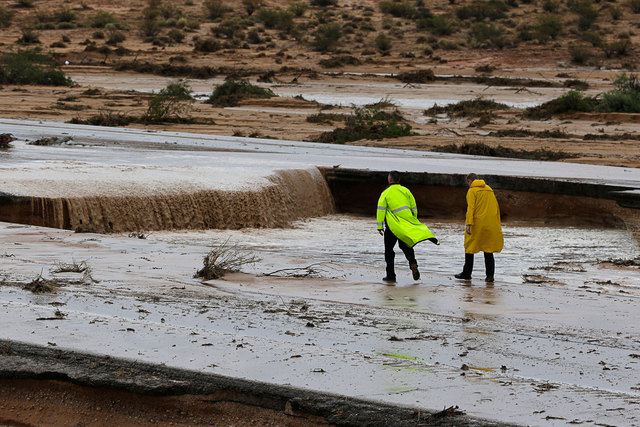 Water flows down the middle of Interstate 15 about 50 miles north of Las Vegas, near Moapa, Monday, Sept. 8, 2014. Rain is expected to fall Saturday near Moapa, causing a flash flood advisory to g ...