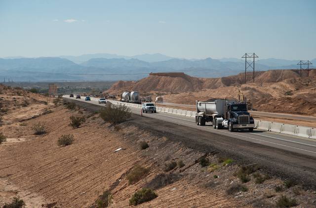 Commuters drive north on Interstate 15 the day after the Nevada Department of Transportation opened up a one lane road on each direction north of Moapa, Nev., on Saturday Sept. 13, 2014. (Martin S ...