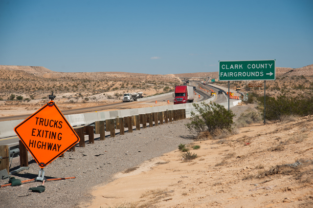 Commuters drive on Interstate 15 the day after the Nevada Department of Transportation opened up a one lane road on each direction north of Moapa, Nev., on Saturday Sept. 13, 2014. (Martin S. Fuen ...