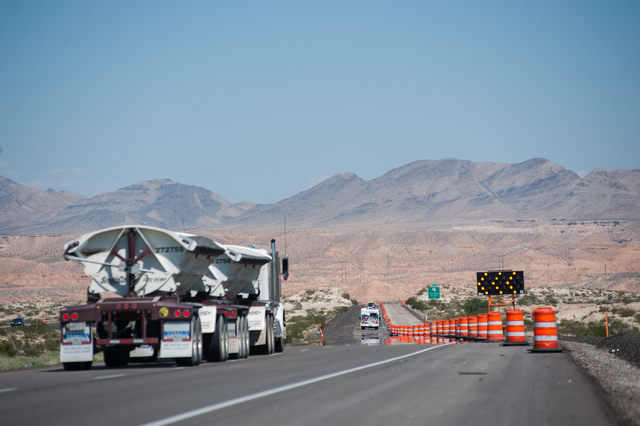 Commuters enter the begining of the one way road south of Moapa, Nev., on Interstate 15N, the day after the Nevada Department of Transportation opened up a one lane road on each direction on Satur ...
