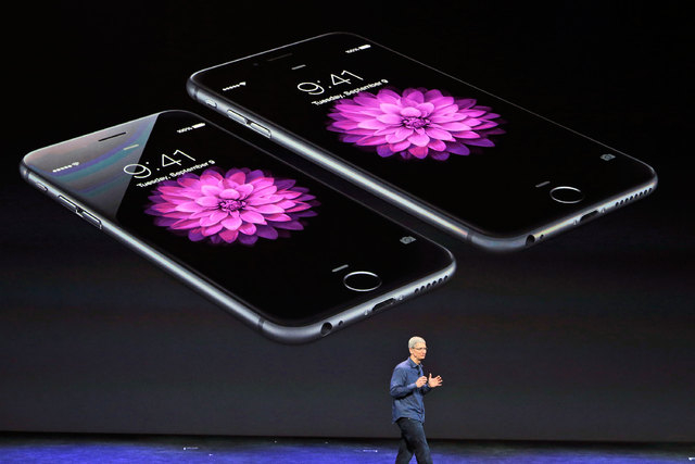 Apple CEO Tim Cook discusses the new iPhone 6 and iPhone 6 plus on Tuesday, Sept. 9, 2014, in Cupertino, California. Due to record orders, customers may have a delay in delivery of iPhone 6 Plus,  ...