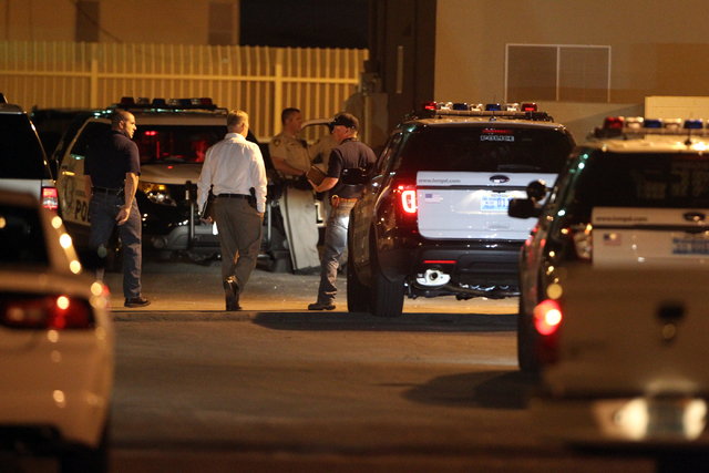 Las Vegas police investigate the scene of a fatal shooting at Sherman Gardens apartment complex at 1701 J Street near Martin Luther King Boulevard and Owens Avenue Thursday, Sept. 11, 2014. A man  ...