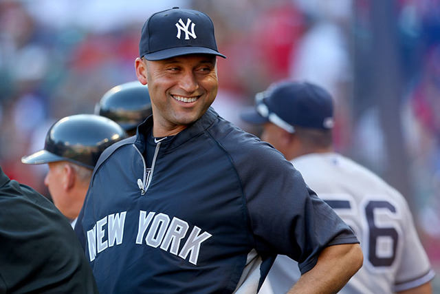 Derek Jeter #2 of the New York Yankees smiles in the dugout during play against the Texas Rangers  at Rangers Ballpark in Arlington on July 22, 2013 in Arlington, Texas. (Ronald Martinez/Getty Im ...
