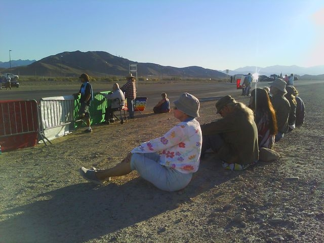 Protesters from the faith-based Nevada Desert Experience sit near a road leading to Creech Air Force Base. Four anti-drone protesters were cited for blocking a road at the base, 45 miles northwest ...